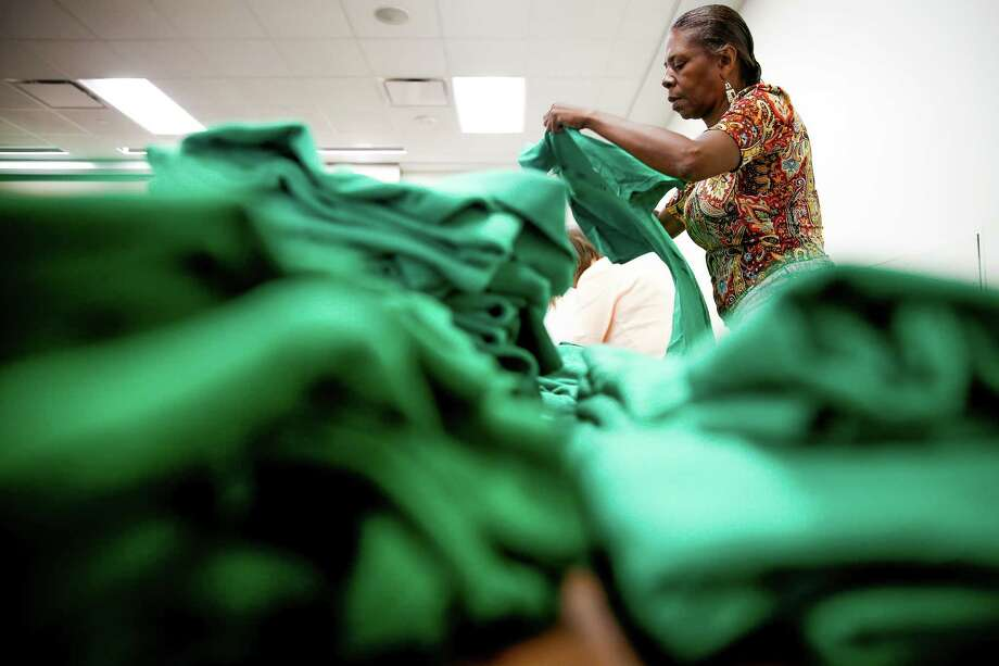 Green Party headquarters office manager Cynthia Joseph prepares shirts for conventioneers upon arrival at the University of Houston. Photo: Michael Ciaglo, Staff / © 2016  Houston Chronicle