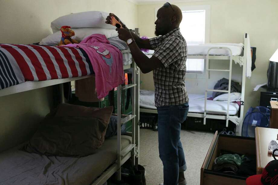 Antwain Jenkins, 42, tidies his sleeping area at the Carson House run by the San Antonio Aids Foundation, Monday, August 1, 2016. The free transitional living residence offers clients a place to stay for up to three months and can house ups to 20 people. The residence has space for women and transgender clients. The foundation will celebrate its 30th anniversary with a fundraiser at the Hyatt Hill Country Resort and Spa, Sunday, August 7. Photo: Jerry Lara, Staff / San Antonio Express-News / © 2016 San Antonio Express-News