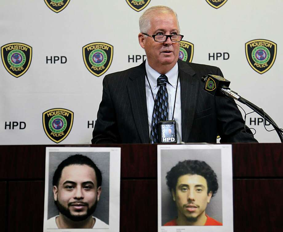 Houston Police Department officer Jim Woods said Michael Arce, left, and Jesse Zelaya are helping steal vehicles that are taken to Mexico.  Photo: James Nielsen, Staff / © 2016  Houston Chronicle