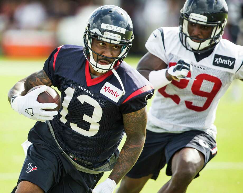 Rookie wide receiver Braxton Miller, left, is putting his athleticism on display for safety Andre Hal and the other Texans defenders during camp. Photo: Brett Coomer, Staff / © 2016 Houston Chronicle