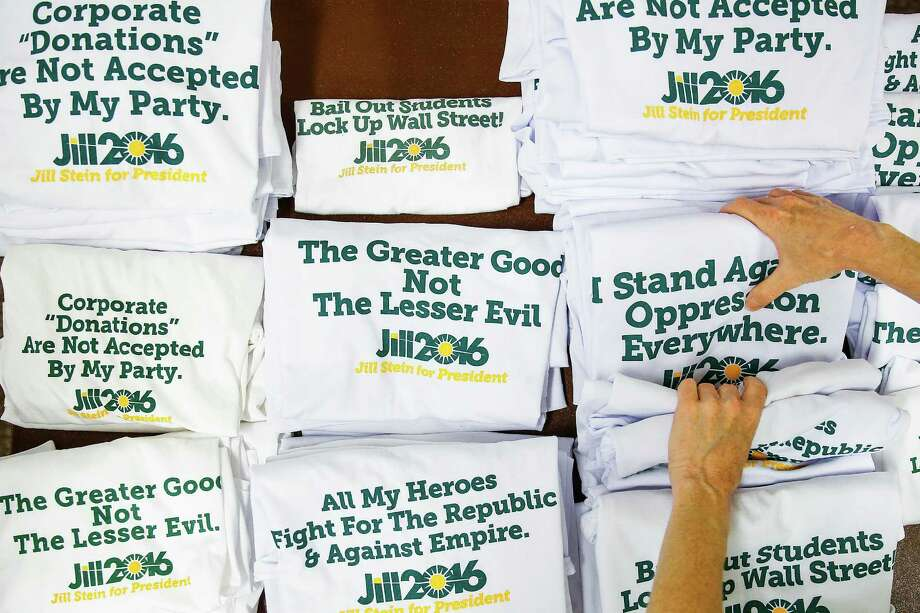 Green Party volunteer Lisa Canar, from Seattle, folds Jill Stein shirts as the Green Party Convention arrives at the University of Houston Thursday, August 4, 2016 in Houston. Photo: Michael Ciaglo, Houston Chronicle / © 2016  Houston Chronicle