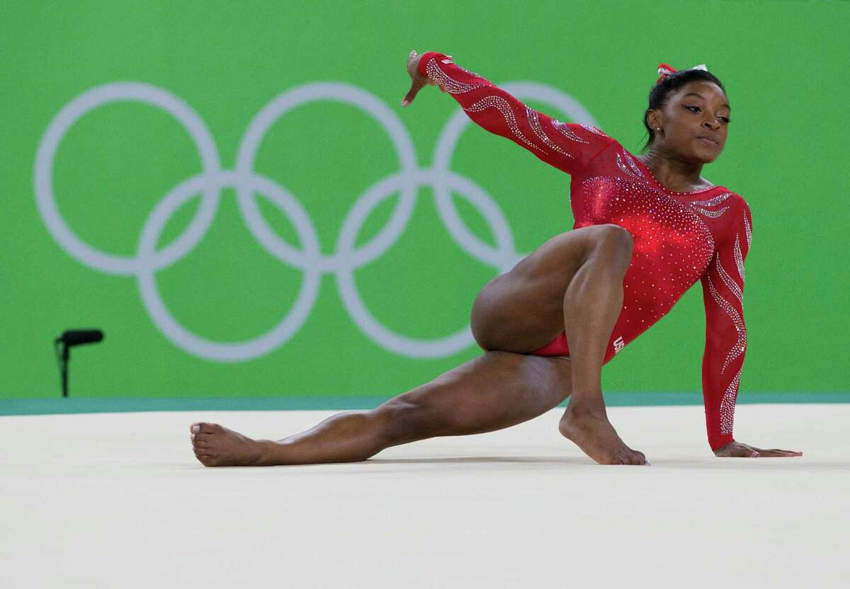 Spring's Simone Biles trains on the floor exercise during Thursday's practice session. The prohibitive favorite could win as many as five gold medals in Rio.