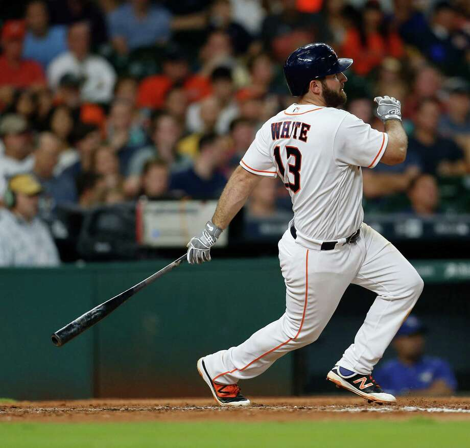 Houston Astros first baseman Tyler White (13) hits a double during the fifth inning of an MLB game at Minute Maid Park, Thursday, Aug. 4, 2016, in Houston. Photo: Karen Warren, Houston Chronicle / © 2016 Houston Chronicle