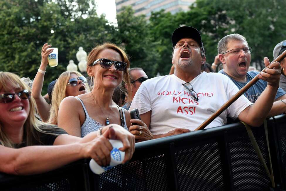 Music fans sing and play air guitar to the music of Molly Hatchet during Alive at Five on Thursday, Aug. 4, 2016, in Albany, N.Y. (Cindy Schultz / Times Union)