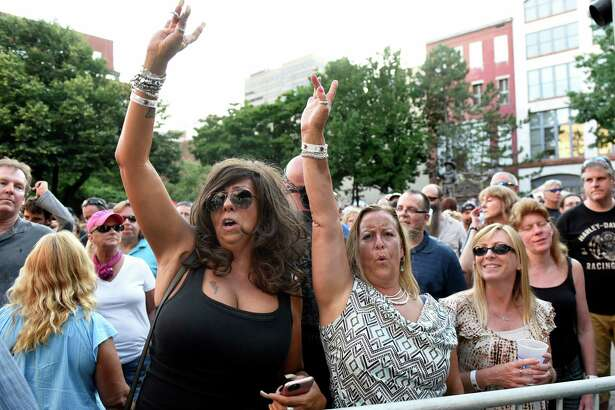 Music fans dance to the music of Molly Hatchet during Alive at Five on Thursday, Aug. 4, 2016, in Albany, N.Y. (Cindy Schultz / Times Union)
