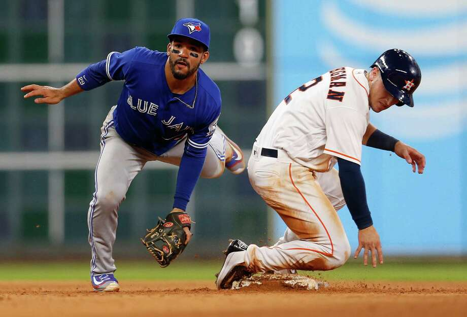 One of the Astros' rare rallies was snuffed out in the sixth when Blue Jays second baseman Devon Travis, left, gets Alex Bregman at second as part of an inning-ending double play Thursday night at Minute Maid Park. Photo: Karen Warren, Staff / © 2016 Houston Chronicle