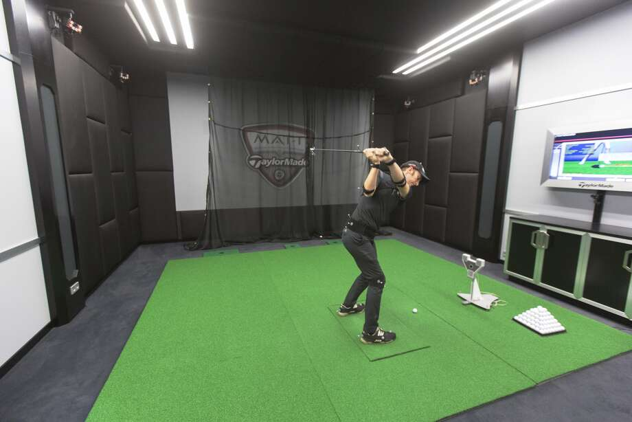 An employee wears sensors as he swings a golf club in the motion analysis technology room at the TaylorMade center of excellence, operated by Adidas, in Herzogenaurach, Germany, on Oct. 8, 2015.