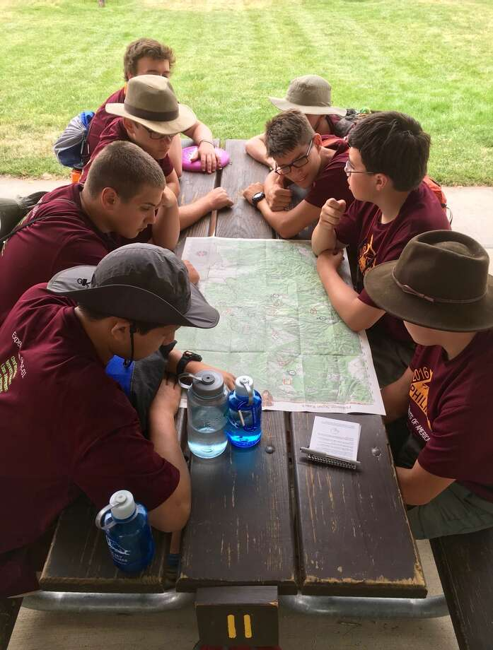 Boy Scouts from Greenwich work out their itinerary in the mountains of New Mexico. Photo: / Contributed: Boy Scouts Of America, Greenwich Council