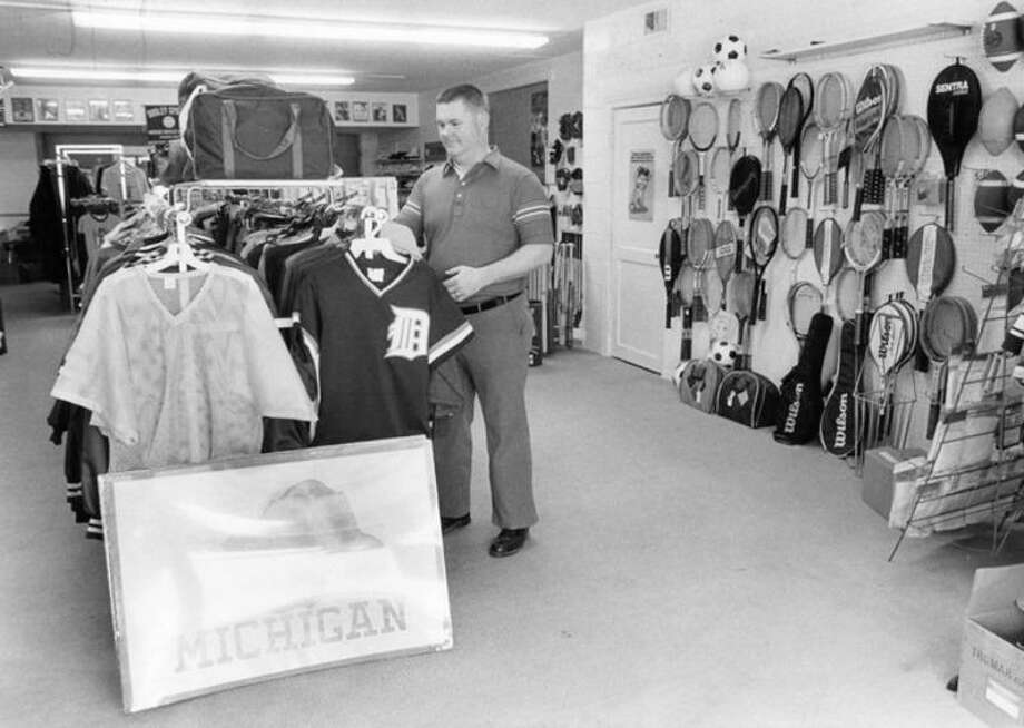 Daily News file photo Cliff Harris is owner of The Jock Shop, 419 S. Saginaw, which specializes in team sales, athletic equipment and trophies.