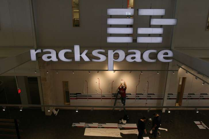 Apollo Global Management is trying to drive down the interest it pays on the loans obtained last month for the purchase of San Antonio-based cloud-services company Rackspace Hosting Inc.