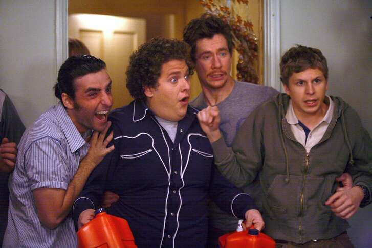 SB-210 : Seth (Jonah Hill, center left) and Evan (Michael Cera, right) can have the night they�ll remember for the rest of their lives in Superbad, the new film from producers Judd Apatow and Shauna Robertson (The 40-Year-Old Virgin), screenwriters Seth Rogen & Evan Goldberg, and director Greg Mottola. Photo Credit : Melissa Moseley.