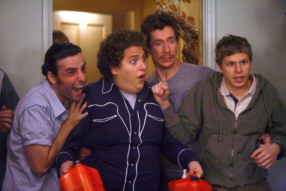 """Seth (Jonah Hill, center left) and Evan (Michael Cera, right) have a night they'll remember for the rest of their lives in """"Superbad,"""" by screenwriters Seth Rogen and Evan Goldberg. Photo: Melissa Moseley SMPSP"""