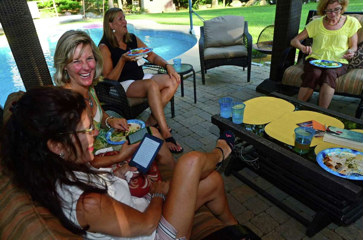 Michelle Mallozzi, Laura Dufort, Debby Denke and Susan Dalton, discuss this month's reading pick,
