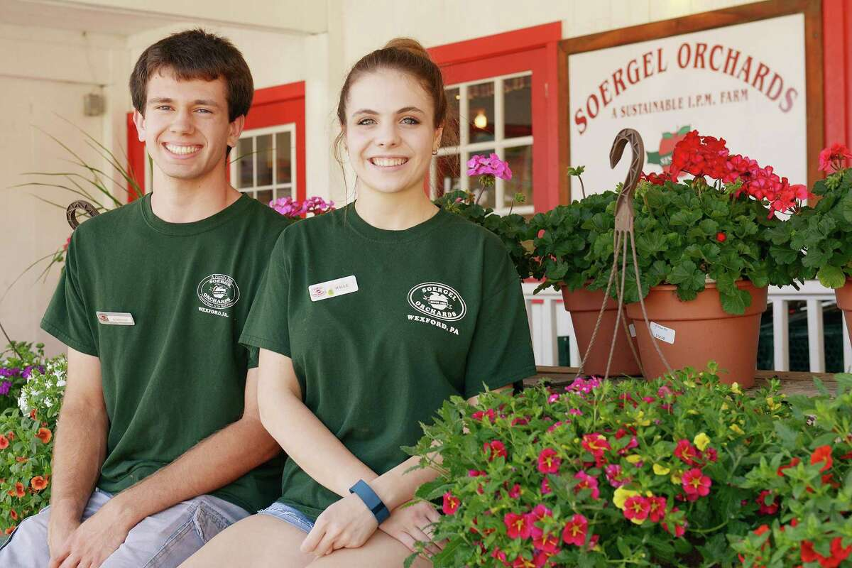 High School seniors Raymond Buehner and Halle Celebrezze have been working part time to save up money for college. They're part of a growing trend.