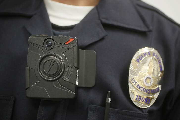 FILE - In this Jan. 15, 2014 file photo a Los Angeles Police officer wears an on-body camera during a demonstration in Los Angeles. Few Connecticut police departments are showing interest in a new state program signed into law in 2015 that requires them to begin using body cameras as of July 1, 2016. The state Office of Policy and Management tells The Associated Press that only 10 of the more than 100 law enforcement agencies in the state have contacted the agency about receiving reimbursement under the program for body camera costs. (AP Photo/Damian Dovarganes, File)