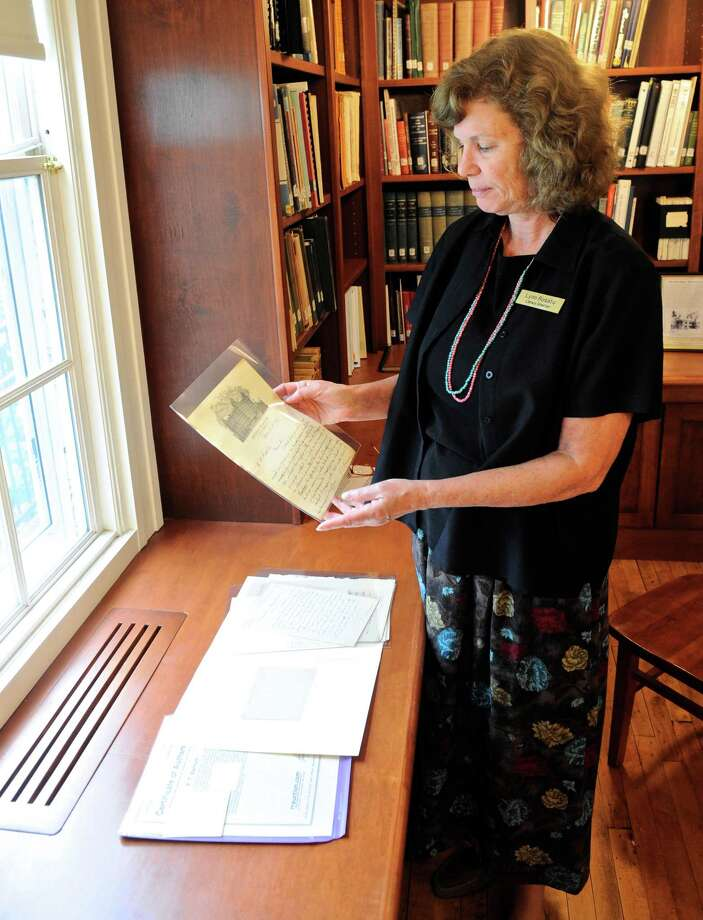 Lynn Rosato, Director of the Bethel Public Library, looks over some correspondence by P.T. Barnum which is part of a P.T. Barnum exhibit at the library. Tuesday, August 2, 2016, in Bethel, Conn. Photo: H John Voorhees III / Hearst Connecticut Media / The News-Times