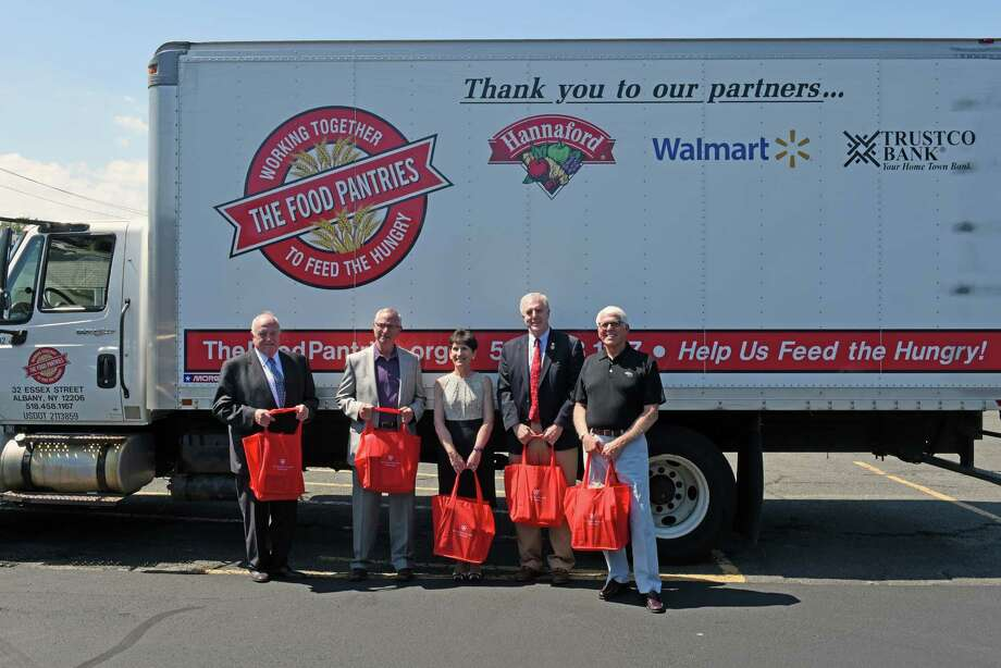 Left to right, Elmer Streeter, director of corporate communications for St. Peter's; Bruce Sowalski. board president; Virginia Golden CEO of St. Peter's; Darius Shahinfar, Albany City treasurer; and Robert W. Lazar, honorary chairman; with St. Peter's Health Partners donated food from a food drive for The Food Pantries on Friday Aug. 5, 2016 in Albany, N.Y. (Michael P. Farrell/Times Union) Photo: Michael P. Farrell / 20037563A