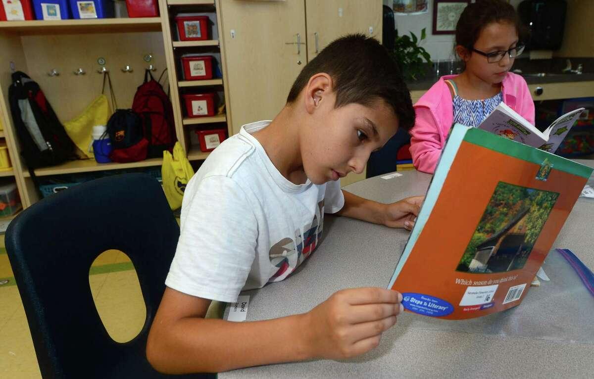 Norwalk Public Schools Summer reading program student, 9 year old David Romero, reads during the program at Naramake Elementary School Tuesday, July 12, 2016. in Norwalk, Conn.