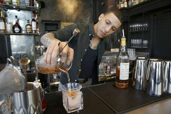 Bar manager Gabriel Lowe make a Sazerac at Black Cat Bar on Wednesday, August 3, 2016, in San Francisco, Calif.