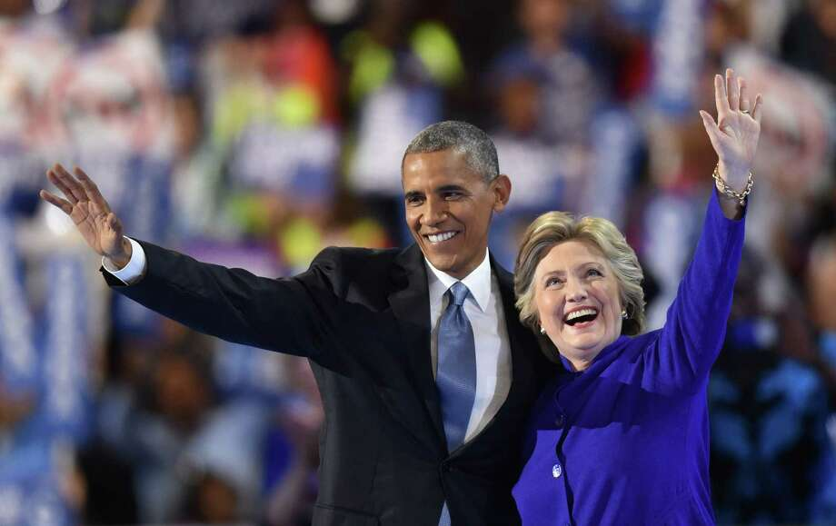 Hillary Clinton's embrace of President Obama's policies cements her as center-left, even if Bernie Sanders forced some concessions to the left. Yet Donald Trump's wildness allows her to simultaneously embrace traditional GOP postures. Photo: NICHOLAS KAMM /AFP /Getty Images / AFP or licensors