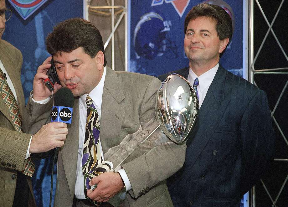 FILE - In this Jan. 29, 1995, file photo, San Francisco 49ers owner Eddie DeBartolo Jr. talks to President Clinton as he holds the Lombardi trophy after his team defeated the San Diego Chargers 49-26 to win Super Bowl XXIX in Miami. DeBartolo, the former football owner who guided the 49ers to greatness in the 1980s and 90sm now raises Clydesdales while operating his Florida commercial development business from afar. He also offers football guidance from a distance, mentoring nephew and 49ers CEO Jed York when asked or needed. (AP Photo/Eric Riseberg) Photo: Eric Riseberg, Associated Press