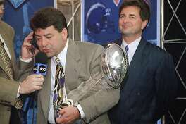 ADVANCE FOR WEEKEND EDITIONS, JAN. 26-27 - FILE - In this Jan. 29, 1995, file photo, San Francisco 49ers owner Eddie DeBartolo Jr. talks to President Clinton as he holds the Lombardi trophy after his team defeated the San Diego Chargers 49-26 to win Super Bowl XXIX in Miami. DeBartolo, the former football owner who guided the 49ers to greatness in the 1980s and 90sm now raises Clydesdales while operating his Florida commercial development business from afar. He also offers football guidance from a distance, mentoring nephew and 49ers CEO Jed York when asked or needed. (AP Photo/Eric Riseberg)