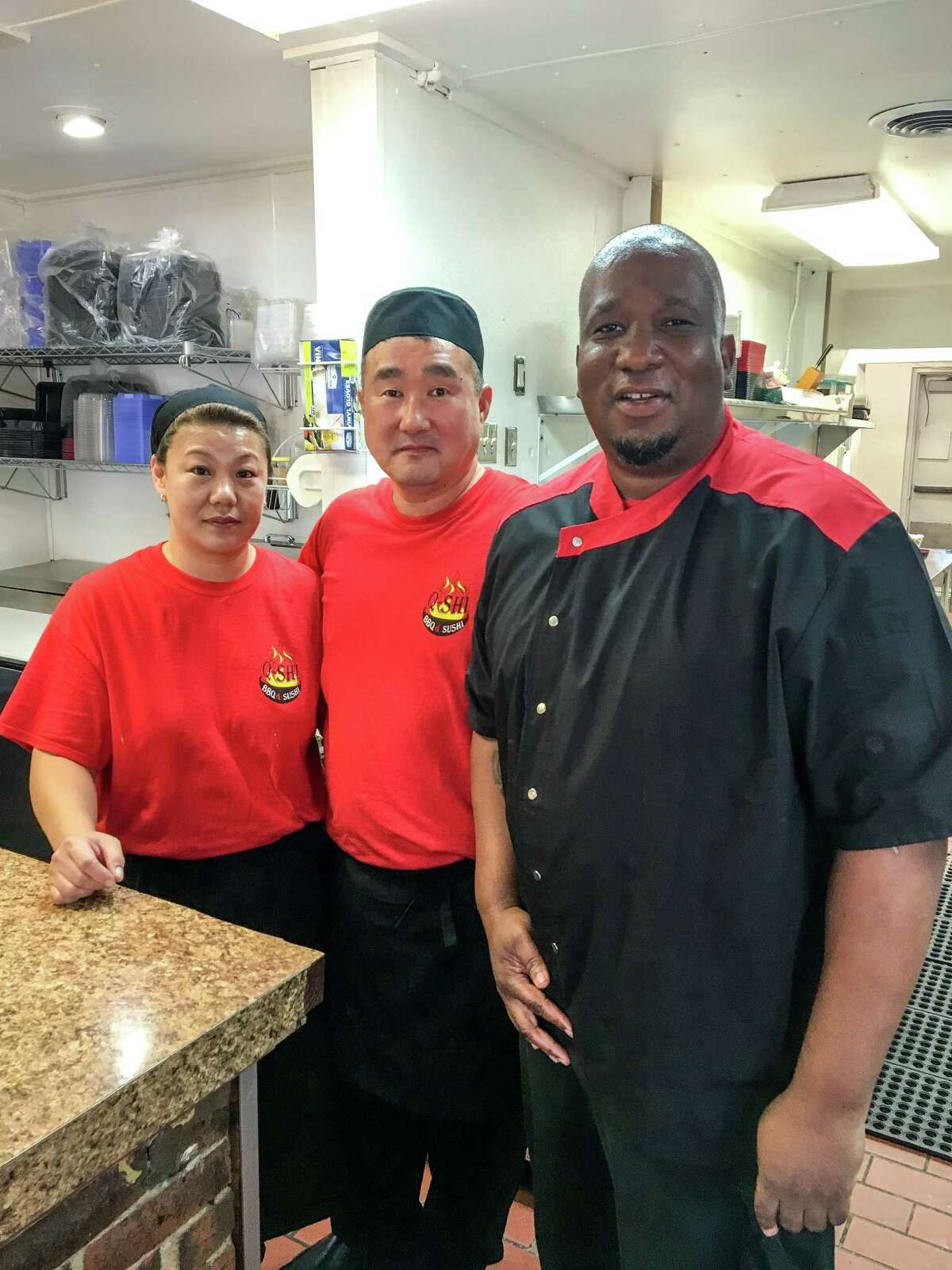 Sushi chefs Jin Oh and Jun Oh, from left, have teamed up with pitmaster Ray Aker at fusion restaurant Q-Shi.