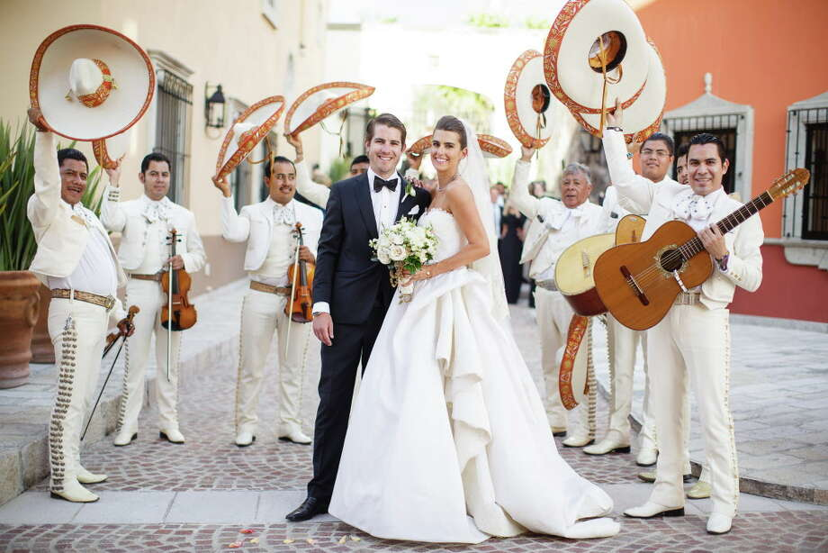 Colby and Kathryn Swain celebrate on their wedding day in San Miguel de Allende, Mexico. Photo: Amber Elliott