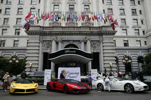 High performance Italian sports cars are lined up for the start of the Prancing Ponies road rally at the Fairmont Hotel in San Francisco, Calif. on Friday, Aug. 5, 2016. Billed as the first all-women road rally in the country, four Ferraris and two Lamborghinis departed on a two-day road trip to Santa Barbara.