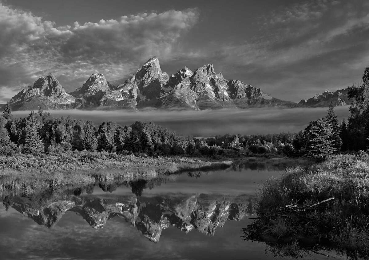 """Mark Burns phtographed all 59 national parks for his """"National Parks Photography Project"""" celebrating the park system's centennial.""""Schwabacher's Landing - Morning Reflections,"""" Grand Teton National Park, Wyoming."""