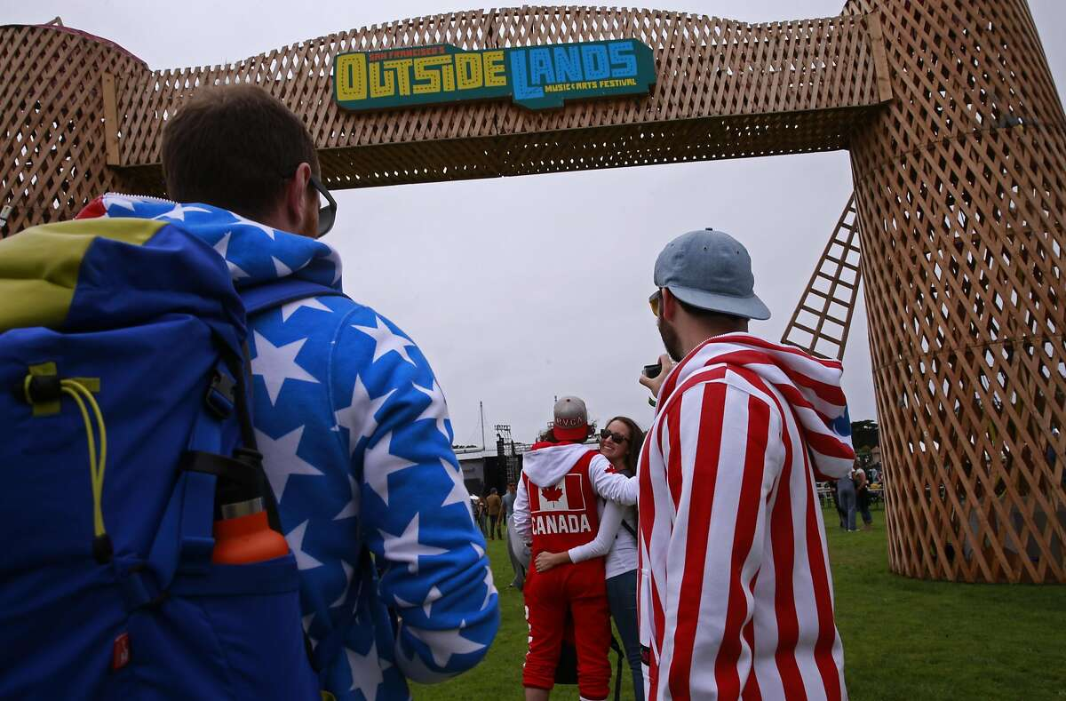 Matt Zumwalt, (left) Dan Wood, (center) and David Drago came dressed up a bit in US Flags and a Canadian flag during day one of the Outside Lands music Festival in Golden Gate Park in San Francisco on Fri. Aug. 5, 2016.