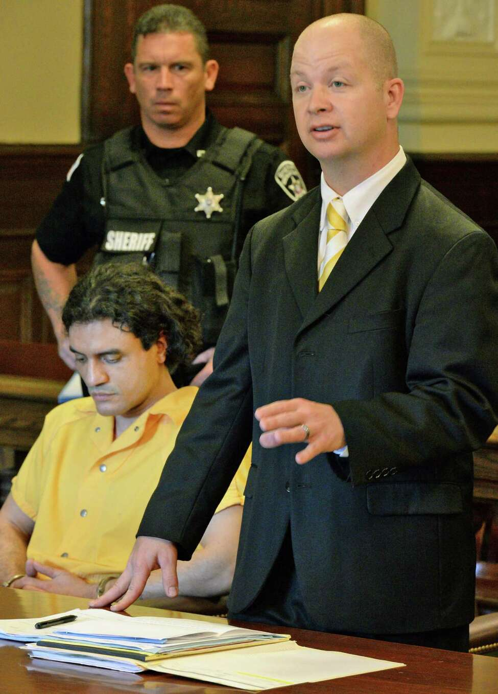 Public defender William Roberts, right, represents Johnny Oquendo, seated, in Rensselaer County Court during an order to show cause hearing for Oquendo's DNA sample as a suspect in the killing of Noel Alkaramla, his step-daughter Friday Aug. 5, 2016 in Troy, NY. (John Carl D'Annibale / Times Union)