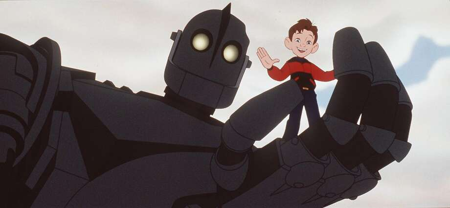 """The Iron Giant"" (voiced by Vin Diesel) finds a friend in 9-year-old Hogarth Hughes (Eli Marienthal)."