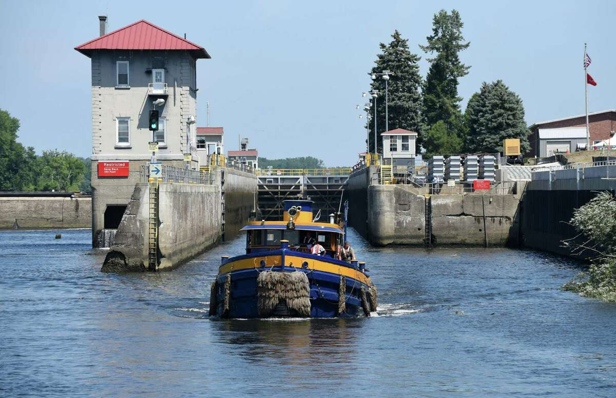 The Gov. Cleveland leaves the Federal Lock heading south on the Hudson River on Friday, Aug. 5, 2016, in Troy, N.Y. The dam and lock are celebrating 100 years of continuous service. It is operated by the U.S. Army Corps of Engineers. (Will Waldron/Times Union)