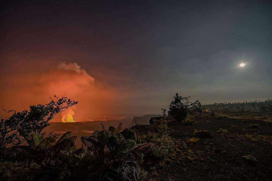 The plume arising from Halemaumau, the summit crater of Kilauea volcano, glows under moonlight, reflecting the lava lake. Photo: Eric Fandrick