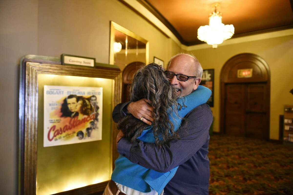 Elliot Lavine, the longtime creator of film programs at both the Roxie and the Castro, hugs longtime friend Jennifer Miko of San Franscisco before he takes part in a farewell show on Tuesday, August 3, 2016 in San Francisco, California.