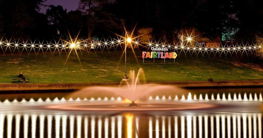 The Children's Fairyland sign at night, as seen from the edge of Lake Merritt in Oakland.