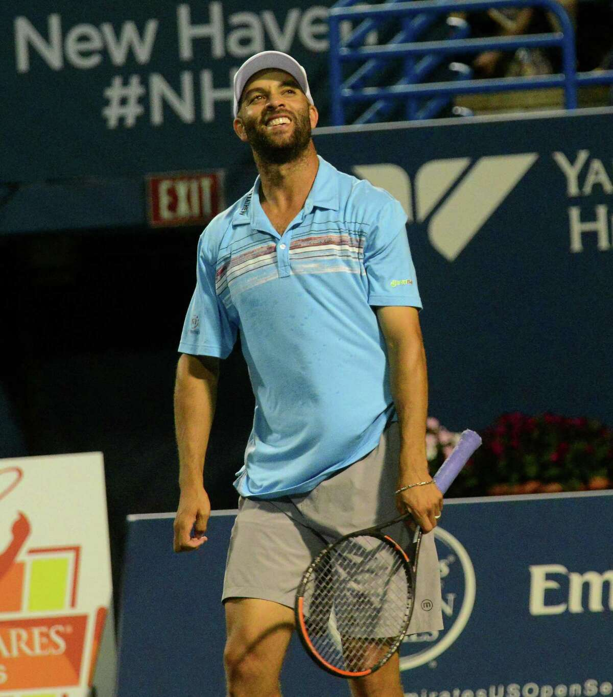 James Blake interacts with the audience as he plays a match against Andy Roddick in the Men's Legend Series at the Connecticut Open tennis tournament in New Haven on Aug. 27, 2015.