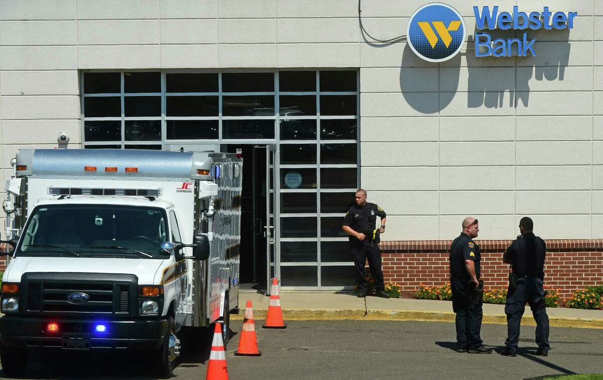 Norwalk police investigate a robbery at the Webster Bank on Connecticut Ave. in Norwalk, Friday, Aug. 5.