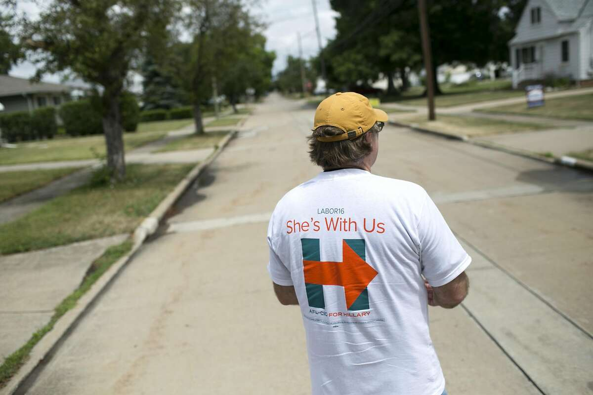 David Sheagley canvases a neighborhood in Cleveland, OH on Saturday, July 16, 2016. Sheagley talked about Trumps poor record on labor issues and urged people to vote for Democratic candidate Hillary Clinton.