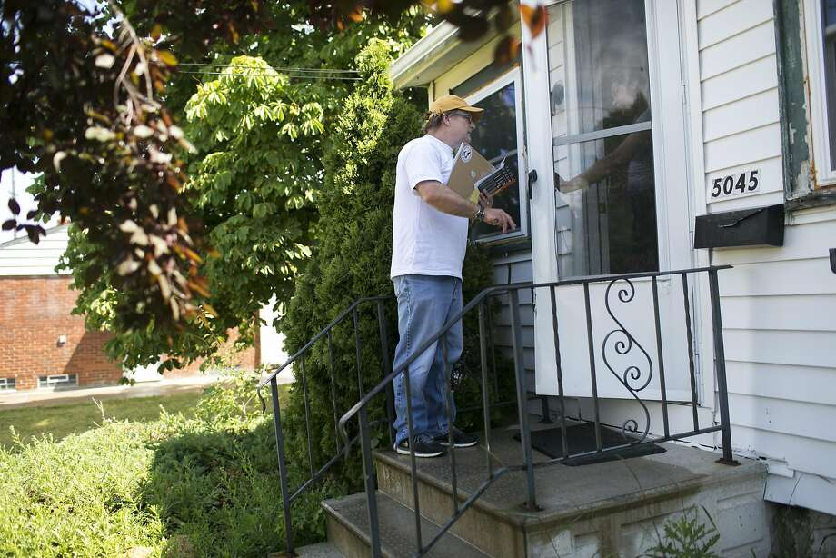 David Sheagley canvasses for Hillary Clinton in Cleveland. Photo: Maddie McGarvey, Special To The Chronicle