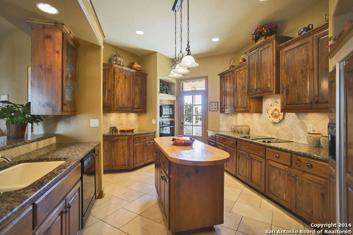 1.217 Santa Fe Trail: $535,0003 beds / 2.5 baths / 3,487 square feetFeatures:Located on a 3.38-acre lot, courtyard, beamed ceiling in living room, upstairs game room, flagstone patios and porch