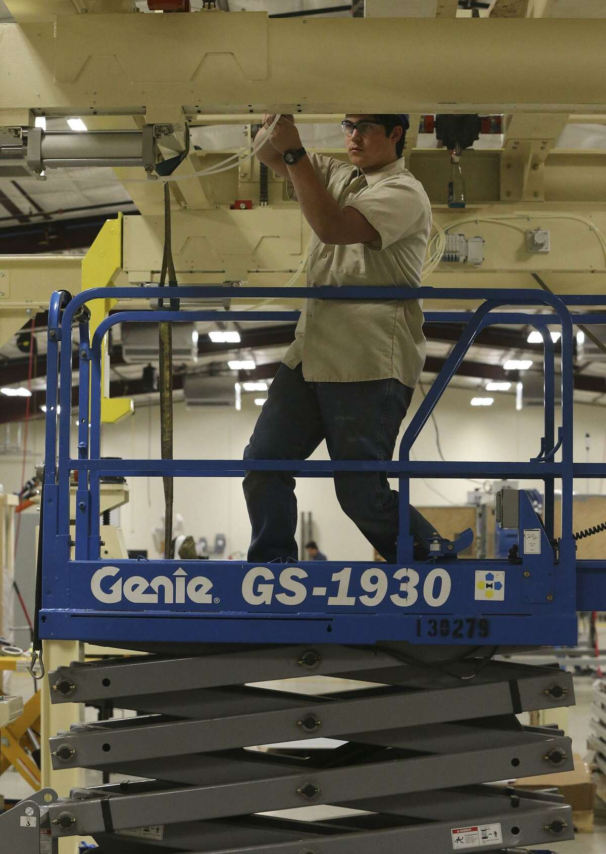 James Mansfied, a paid intern at Innovation Technology Machinery in Schertz, works on a transfer system for Toyota trucks. The Manufacturing Outlook Survey conducted by the Dallas Fed for February saw more manufacturers discussing market basics rather than Donald Trump. Since Trump's November election, many manufacturers had commented on the potential benefits of a business-friendly Trump administration.