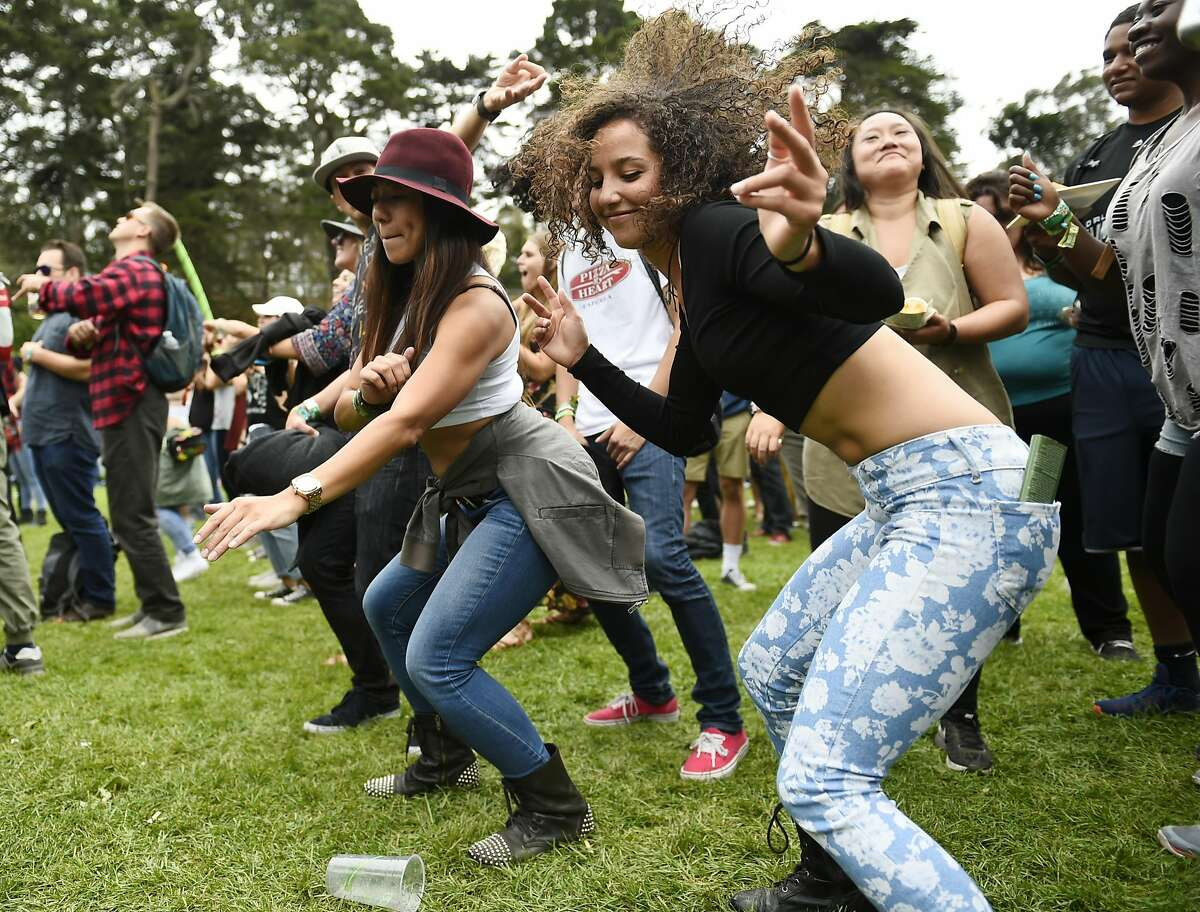 Michelle Gong and Isabele Silveira dance during a Jidenna performance on the first day of the Outside Lands music festival on Friday, August 5, 2016 in San Francisco, California.