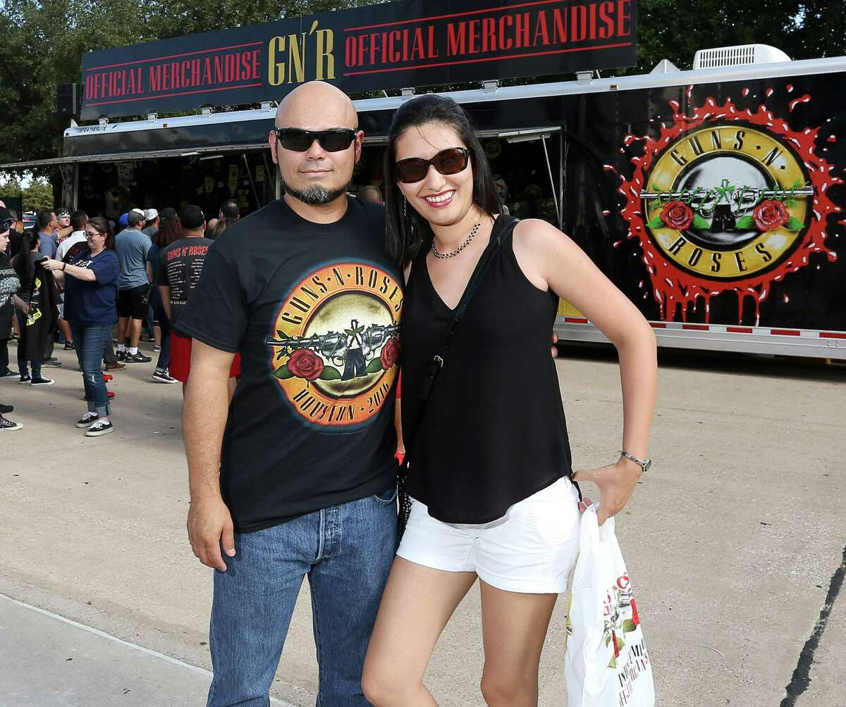 People pose for a photo before the Guns N' Roses concert at NRG Stadium, Friday, Aug. 5, 2016, in Houston.