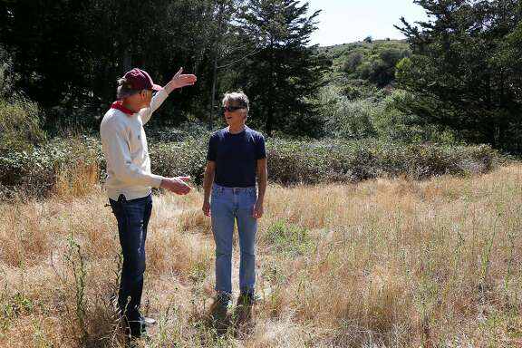 Bill Monnet, (left) and Leon Hunting stand in a golden meadow inside the two acre parcel and describe the bounty of water and habitat that the Butte/Lincoln Open Space provides for wildlife in Sausalito, Calif. on Friday, August 5, 2016.