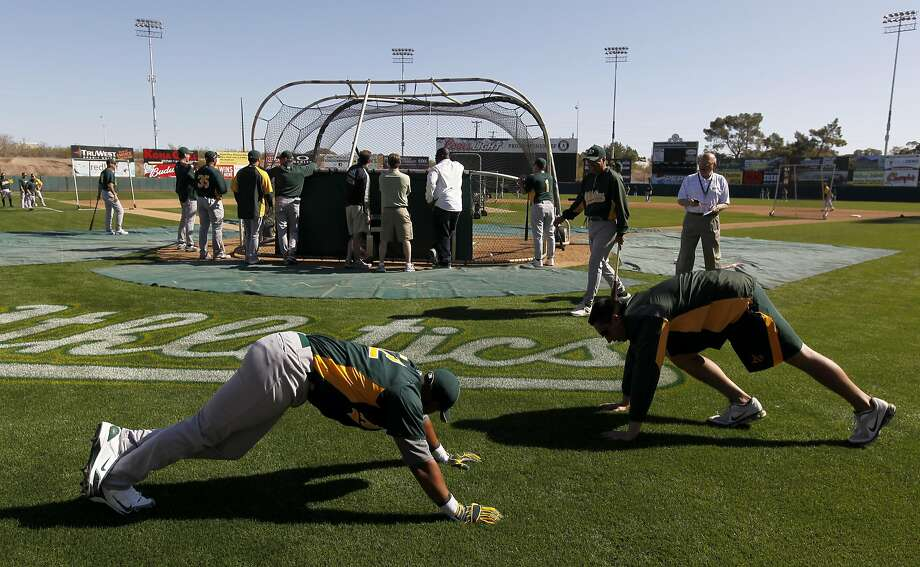 A's coach suspended for spying on players