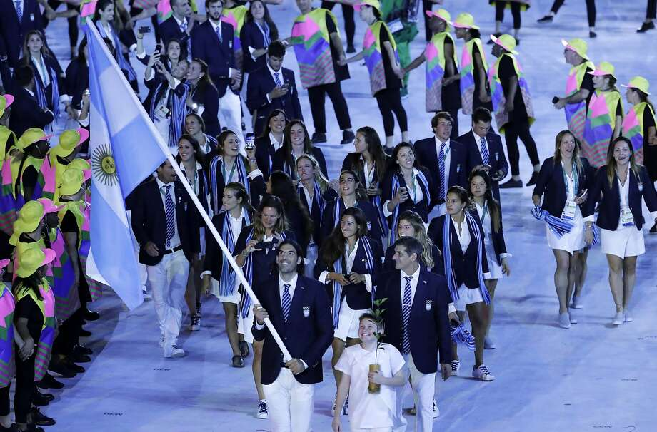 Michael Phelps could break the law at the Opening Ceremony
