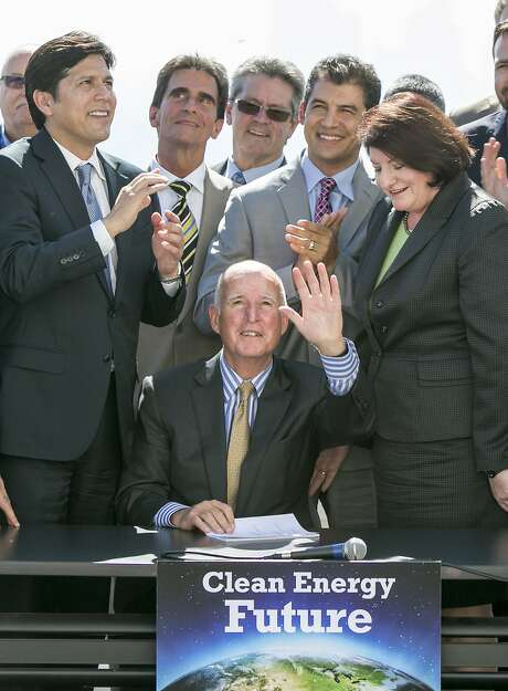 FILE -- In this Oct. 7, 2015 file photo, California Gov. Jerry Brown, center, waves after signing bill SB350 by Senate President pro Tempore Kevin De Leon, left, to combat climate change. The race to replace Brown in 2018 is emerging as a potentially historic and crowded competition that could bring the state its first Asian governor, the first Hispanic in modern times or, maybe, the first woman to hold the job. (AP Photo/Damian Dovarganes, File) Photo: Damian Dovarganes, AP