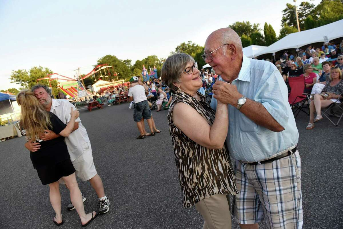 Karen Stevens of Clifton Park, center, dances with her father, Patsy Benny, of Scotia to the music of the band Harmony during the annual Festa on Friday, Aug. 5, 2016, at Our Lady Queen of Peace in Rotterdam, N.Y. The event features Italian food, music, rides and games and continues Saturday from 5 to 11 p.m. and Sunday from 3 to 9 p.m. (Cindy Schultz / Times Union)